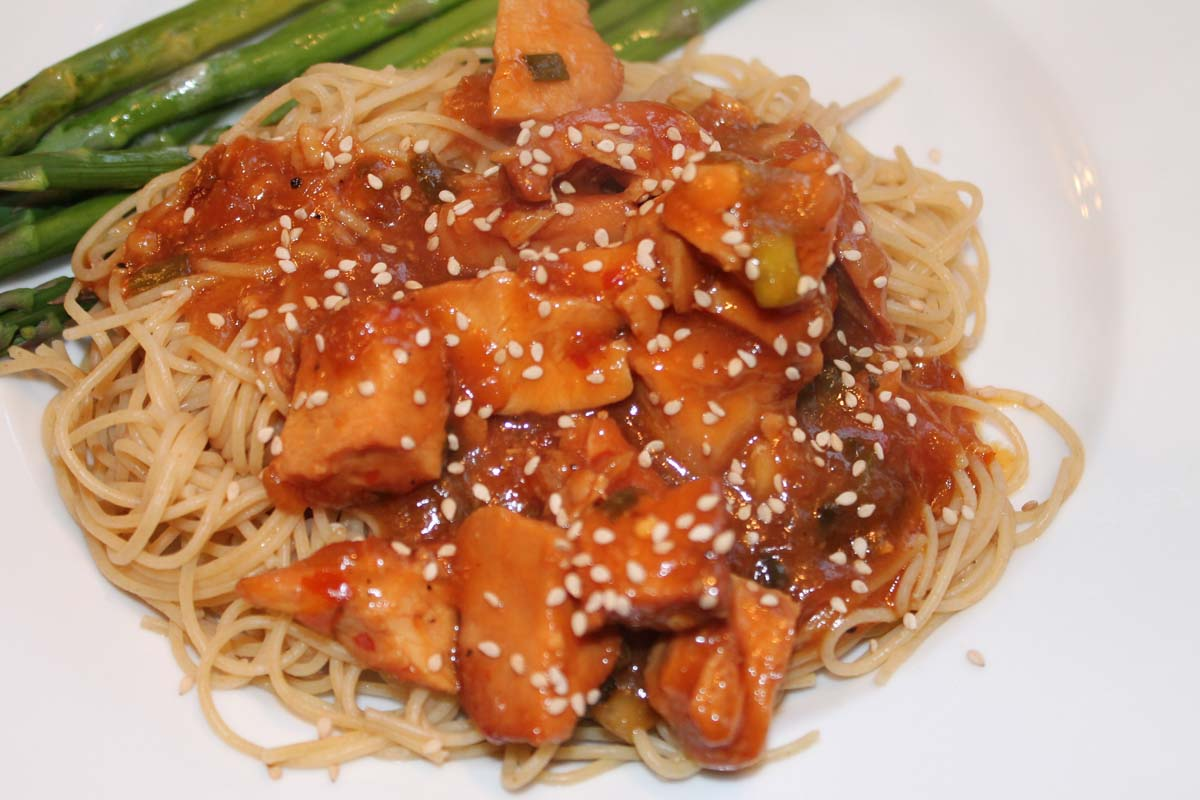 sesame chicken over noodles